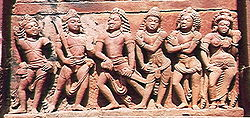 The central figure is Yudhishthira ; the two to his left are Bhima and Arjuna . Nakula and Sahadeva are to his right. Their wife, at far right, is Draupadi. Deogarh, Dasavatar temple. (Source:Wikipedia)