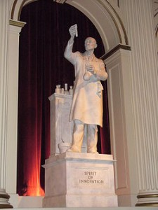 A personification of innovation as represented by a statue in The American Adventure in the World Showcase pavilion of Walt Disney World's Epcot.(Source:Wikipedia)